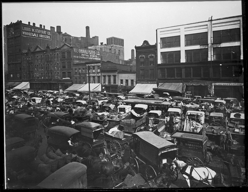 West Randolph Street market (Haymarket Square). Description: West Randolph Street market (Haymarket Square); Chicago, IL. Source: ICHi-19202. Chicago History Museum. Reproduction of photograph, photographer - Barnes Crosby. Date: ca. 1905.