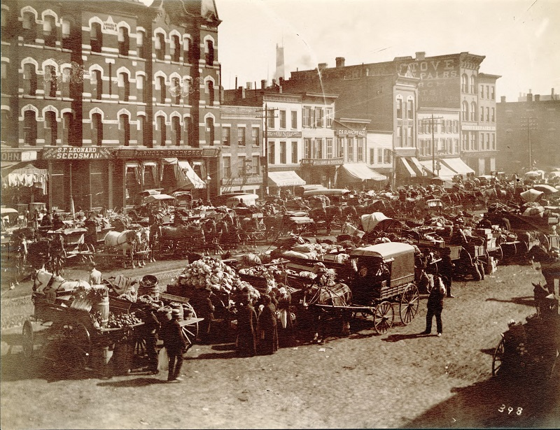 View of Randolph Street Market, west of Des Plaines Street. Description: View of Randolph Street Market, west of Des Plaines Street, Chicago, IL. Source: ICHi-31327. Chicago History Museum. Reproduction of photographic print, photographer - John W. Taylor. Date: ca. 1890.