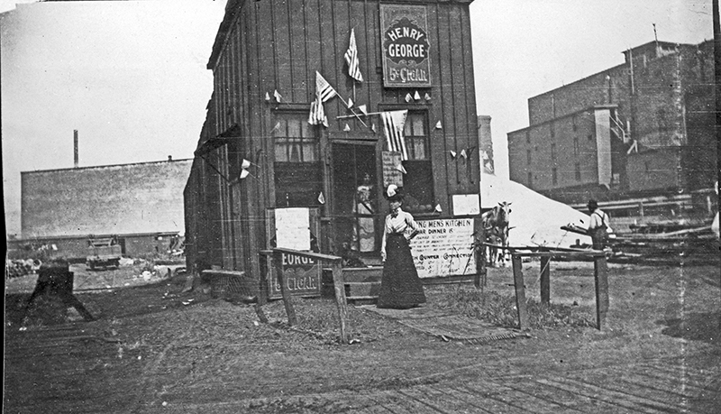 Just coming from the stockyards, lunchroom in stockyards district. Description: Just coming from the stockyards, lunchroom in stockyards district; Chicago, IL. Source: ICH-i15113. Reproduction of photograph, photographer unknown. Date: 1900.