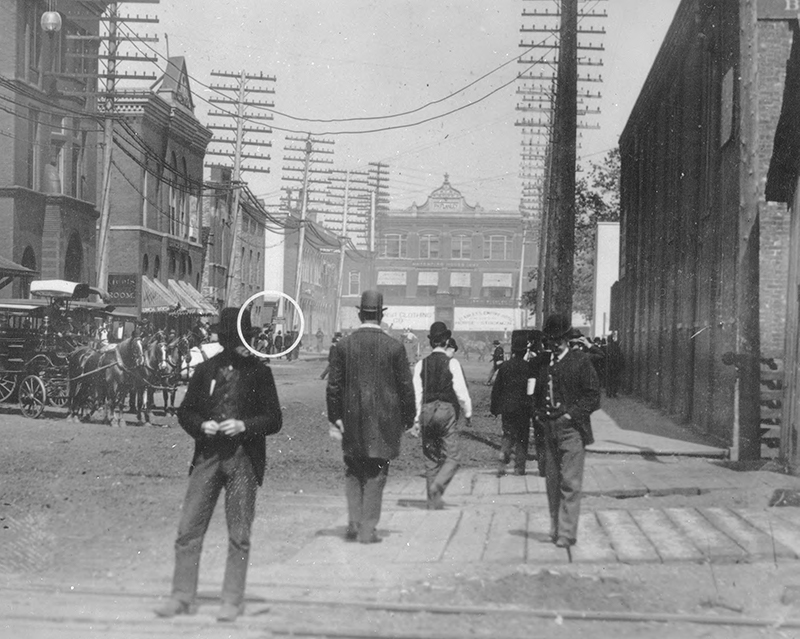 Exchange Street, 200 feet west of the main entrance to the Union Stockyards. Description: Exchange Street, 200 feet west of the main entrance to the Union Stockyards; Chicago IL. Source: ICHi-32961. Chicago History Museum. Reproduction of photographic print, photographer unknown. Chicago History Museum. Date: 1893.
