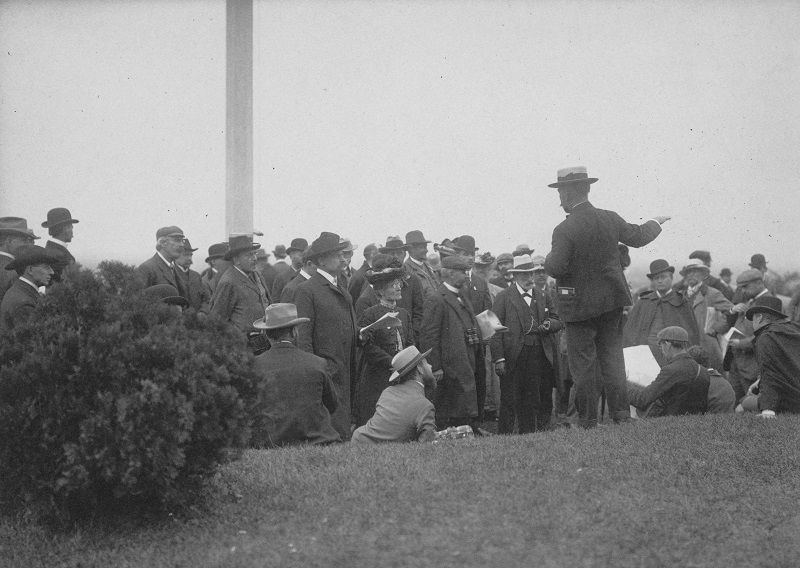 Man giving a speech to a group of people. Description: Man giving a speech to a group of people; Chicago, IL. Source: ICHi-52242. Chicago History Museum. Reproduction of photographic print, photographer unknown. Date: early 1890s.